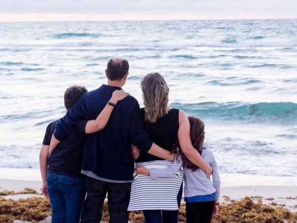 a family of four on a beach