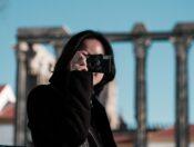 woman in black jacket wearing black sunglasses